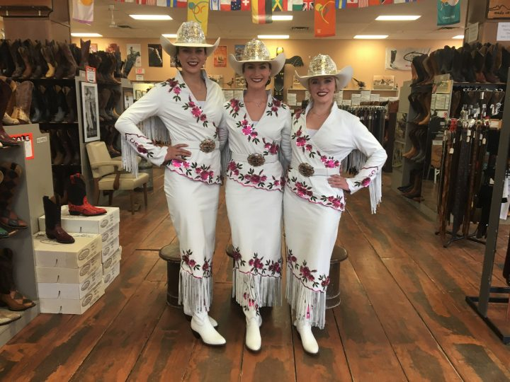 This year's Stampede Queen Carly Heath (centre) and Princesses Keily Stewart (left) and Courtney Dingreville (right) picked up their outfits on Monday.