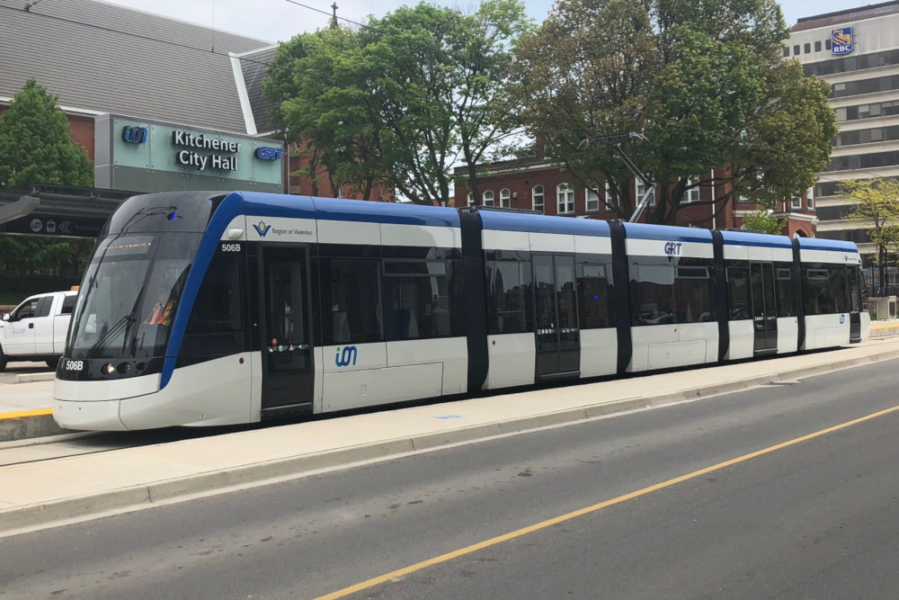 An ION LRT vehicle stops at Kitchener City Hall station.