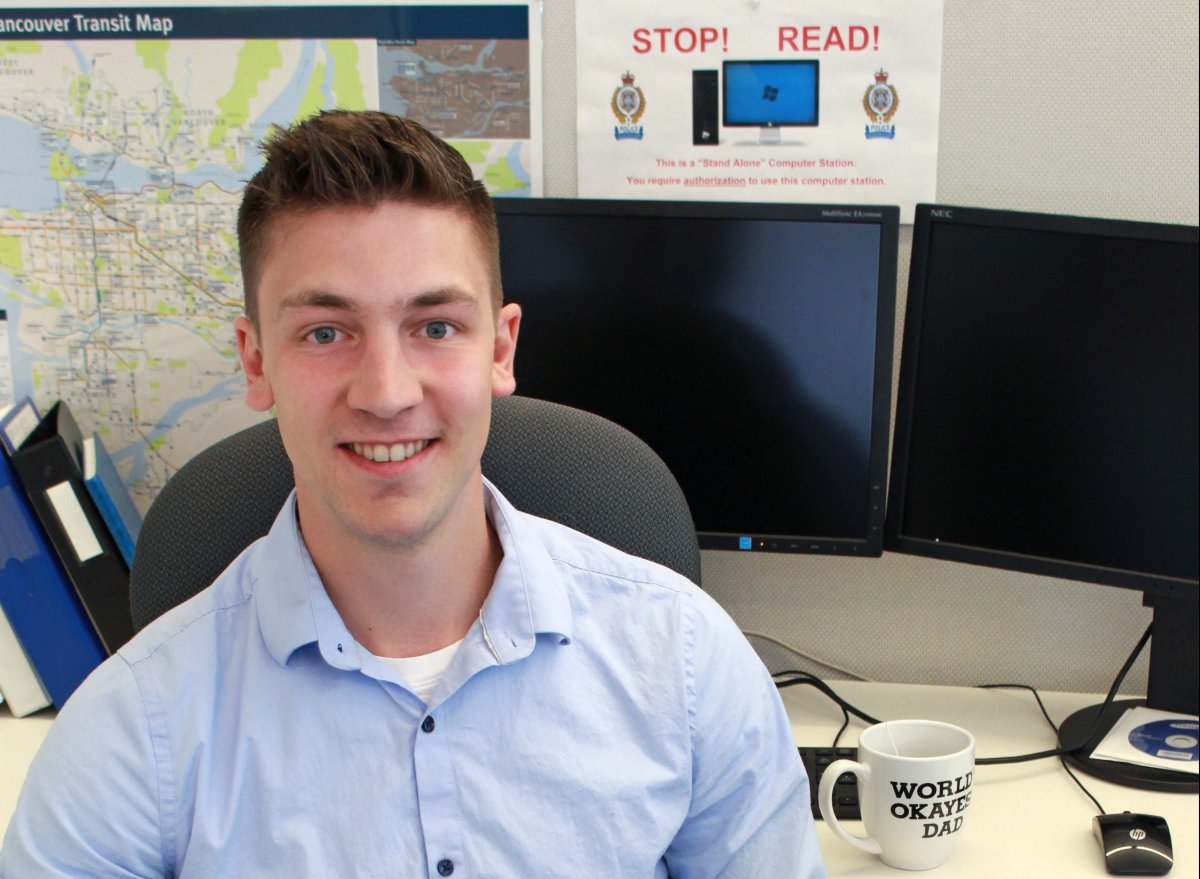 Metro Vancouver Transit Police Const. Josh Harms seen back at his desk in New Westminster Tuesday, May 7, 2019. Harms was shot in the line of duty at Scott Road SkyTrain station in Surrey on Jan. 30, 2019.