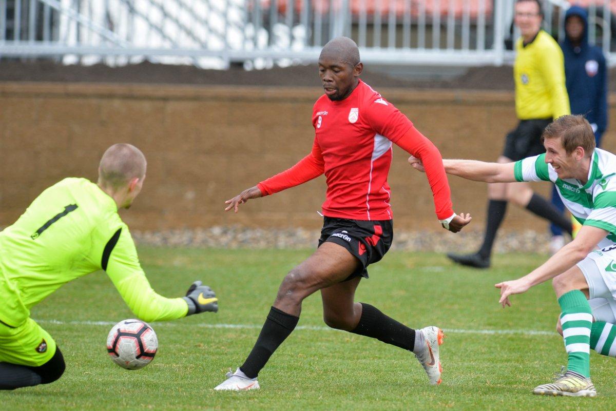 Cavalry FC forward Jordan Brown evades Foothills FC defenders in a April 26, 2019, preseason game.