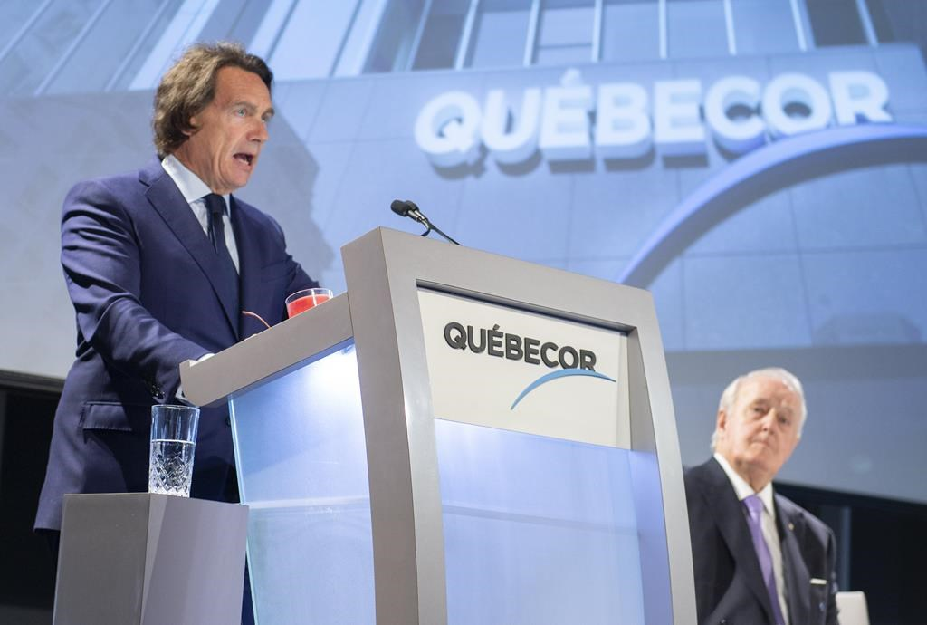 Quebecor president and CEO Pierre Karl Peladeau addresses the media company's annual meeting as the chairman of the board Brian Mulroney looks on in Montreal on Thursday, May 9, 2019.
