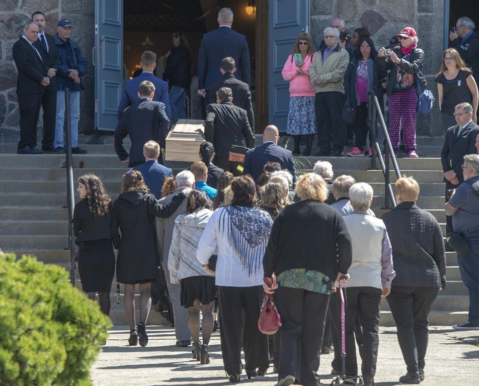The casket of a seven-year-old girl who was found in critical condition inside of a home and later died is carried to the church for funeral services, Thursday, May 9, 2019 in Granby, Que.