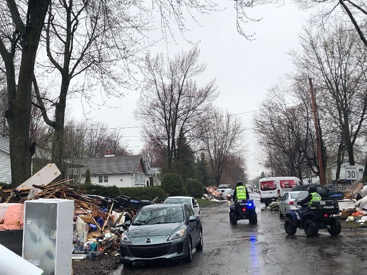Demolition work has begun on flood-stricken homes in the community west of Montreal.
