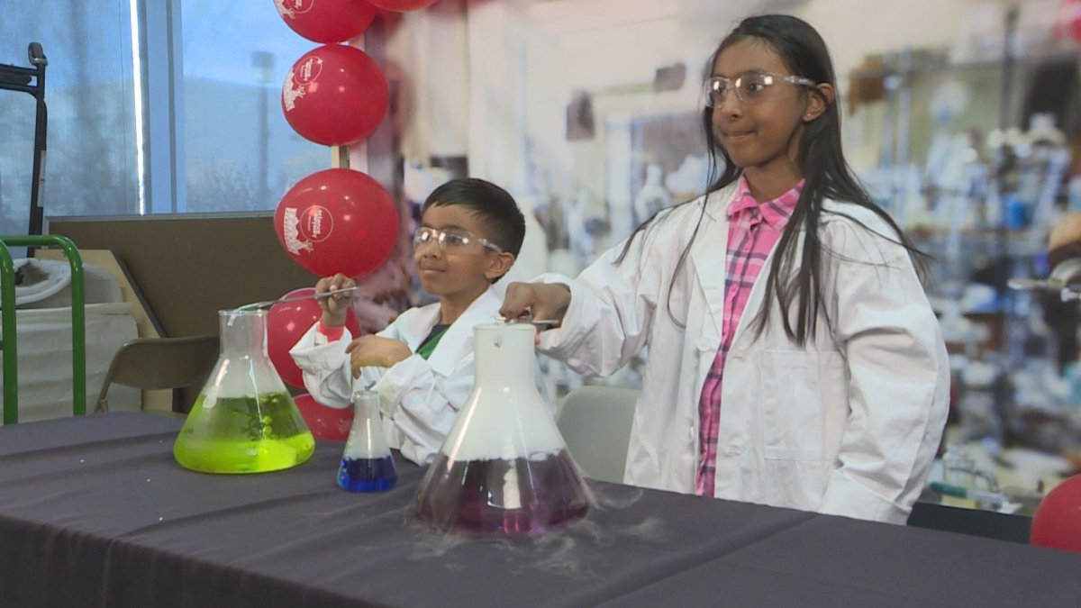 Two aspiring scientist pose at the 'Science Rendezvous' photo booth at the University of Manitoba.