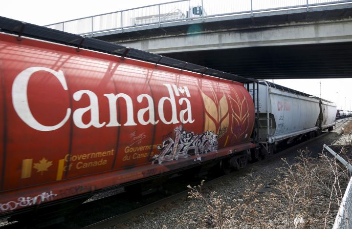 A Canadian Pacific Rail train hauling grain passes through Calgary, Thursday, May 1, 2014. Canada's two largest railways say they moved record grain tonnage out of Western Canada in April.