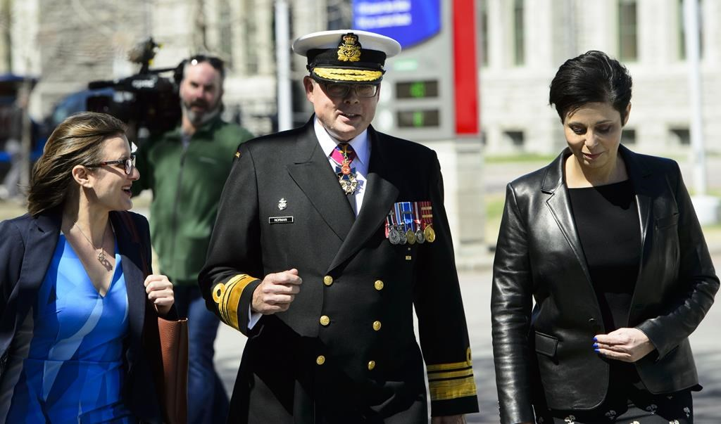 Vice-Admiral Mark Norman walks with his lawyers Marie Henein and Christine Mainville as they leave court in Ottawa on Wednesday, May 8, 2019.