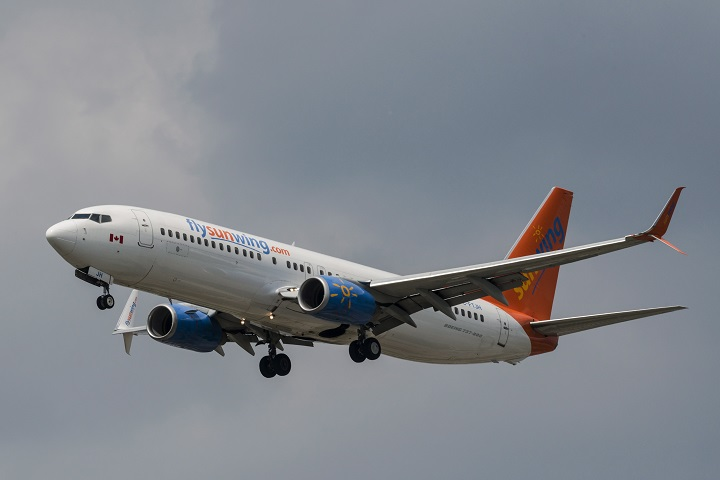 A Sunwing Boeing 737-800 passenger plane prepares to land at Pearson International Airport in Toronto on August 2, 2017.