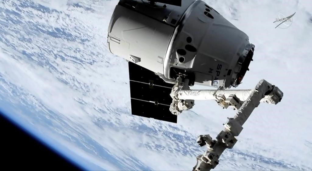 In this image taken from NASA Television, a SpaceX shipment prepares to arrive at the International Space Station following a weekend launch, Monday, May 6, 2019.