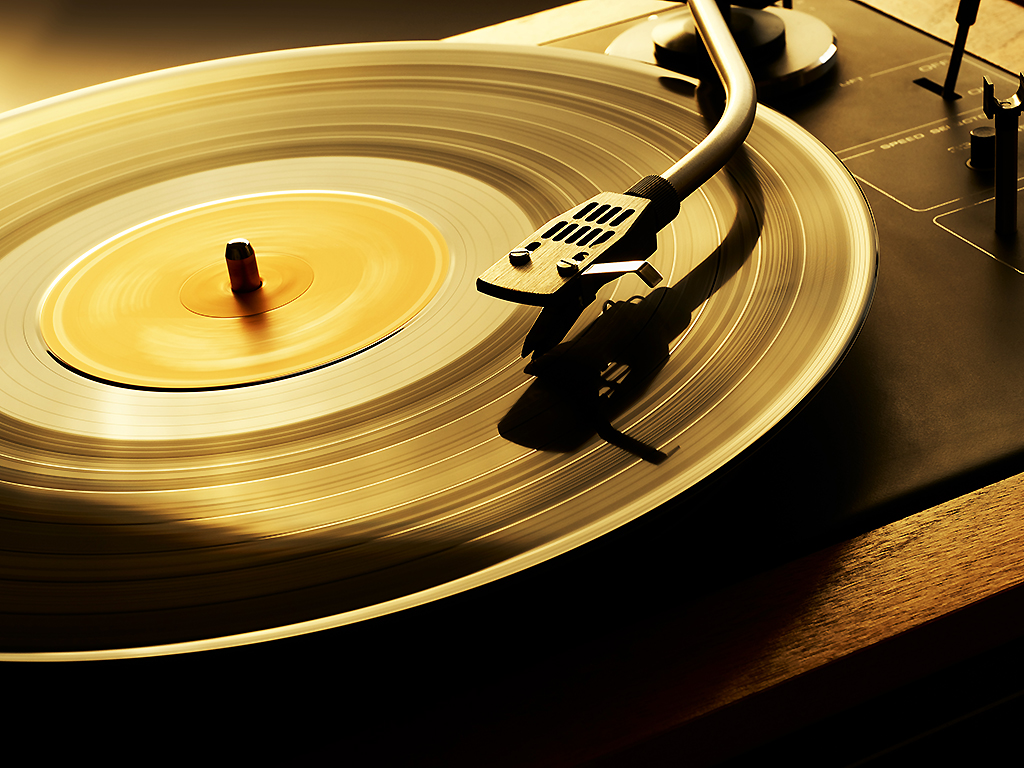 A vinyl record plays on a turntable.