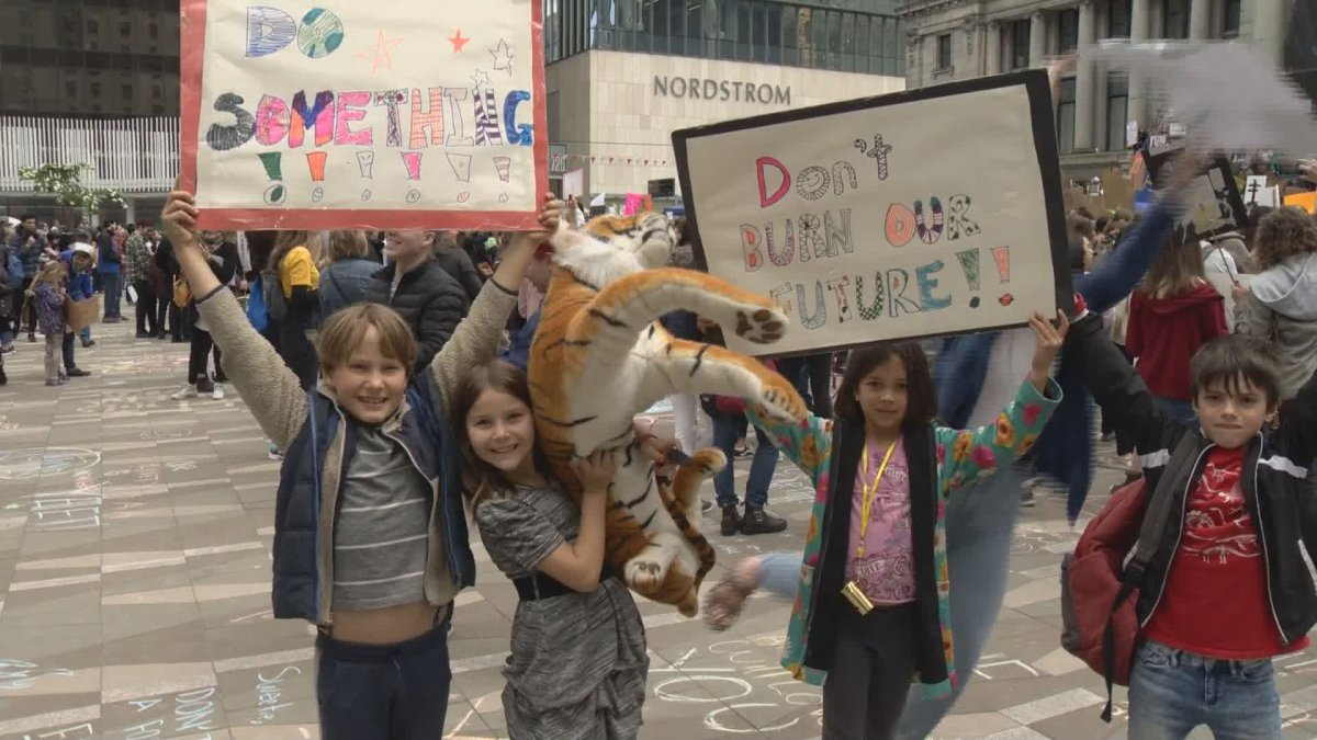 Students walk out of classes in Vancouver for a Climate Strike on Friday.