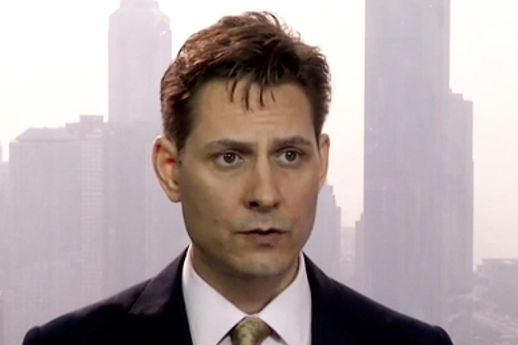 FILE - In this file image made from March 28, 2018, video, Michael Kovrig, an adviser with the International Crisis Group, a Brussels-based non-governmental organization, speaks during an interview in Hong Kong. Diplomats have visited a Canadian think tank expert on Monday, May 13, 2019, whose detention in China is believed to be an attempt to pressure Canada to release Huawei executive Meng Wanzhou.