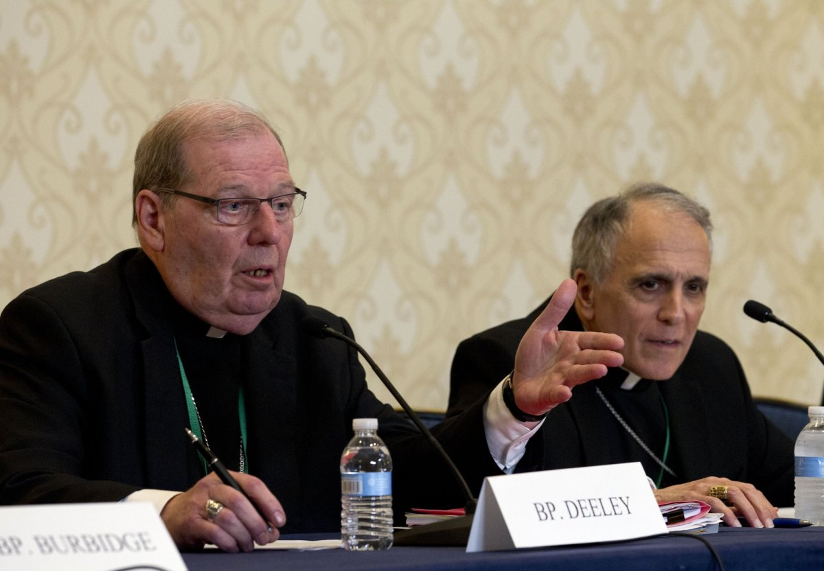 Robert Deeley, left, Bishop of the Diocese of Portland, accompanied by Cardinal Daniel DiNardo, of the Archdiocese of Galveston-Houston and President of the United States Conference of Catholic Bishops (USCCB), speaks during a news conference at the United States Conference of Catholic Bishops (USCCB), 2019 Spring meetings in Baltimore, Md., Tuesday, Jun 11, 2019.