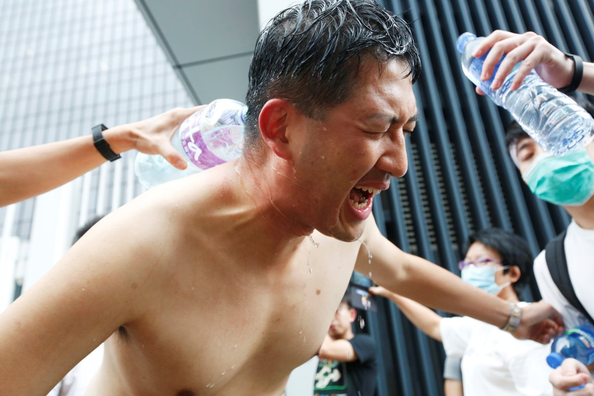 Protesters help pro-democracy lawmaker Lam Cheuk-ting who got pepper-sprayed during a demonstration against a proposed extradition bill, in Hong Kong, China June 12, 2019.