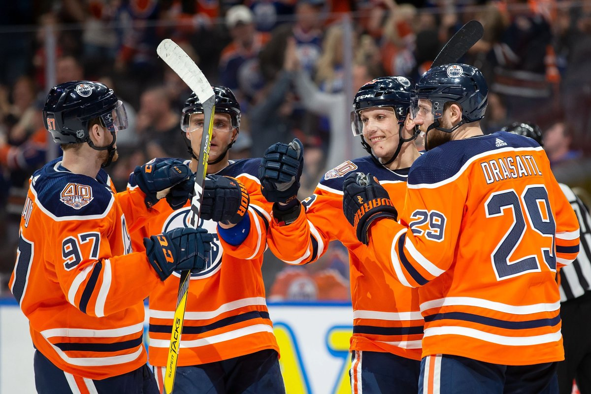 Edmonton Oilers' Connor McDavid (97), Andrej Sekera (2), Matthew Benning (83) and Leon Draisaitl (29) celebrate Benning's goal against the New Jersey Devils during second period NHL action at Rogers Place in Edmonton, Alta., on Wednesday, March 13, 2019.