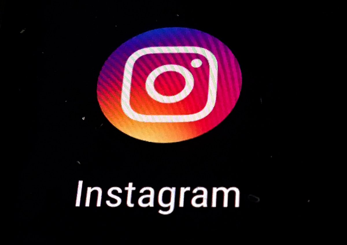 In this Nov. 29, 2018 file photo, the Instagram app logo is displayed on a mobile screen in Los Angeles.