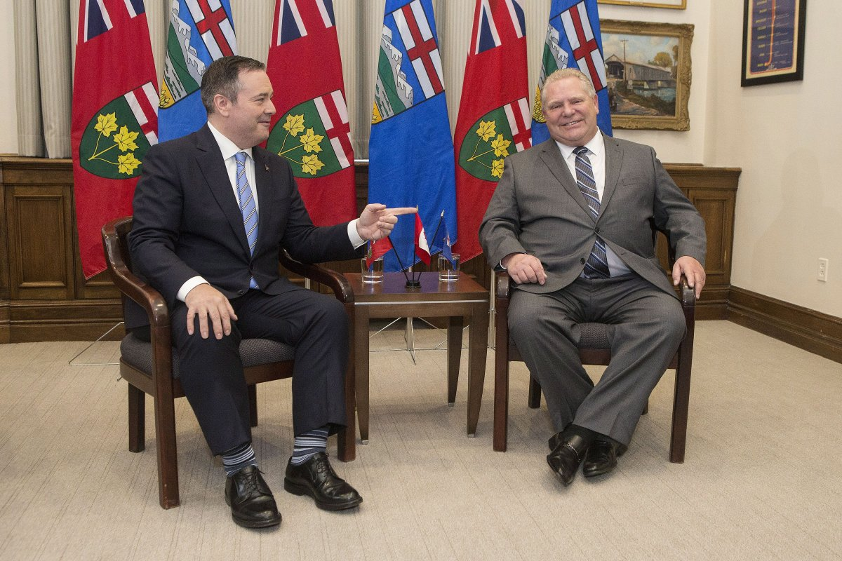 Ontario Premier Doug Ford, right, poses with Alberta Premier Jason Kenney at the Ontario legislature in Toronto on Friday, May 3, 2019.