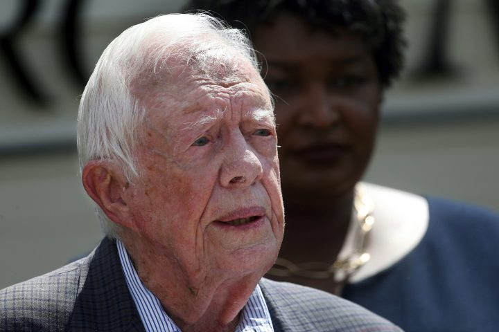 In this Sept. 18, 2018 file photo, former President Jimmy Carter speaks during a news conference, in Plains, Ga. A spokeswoman says former U.S. President Jimmy Carter says he has broken his hip. She said that Carter underwent surgery at a medical center in Americus, Ga.
