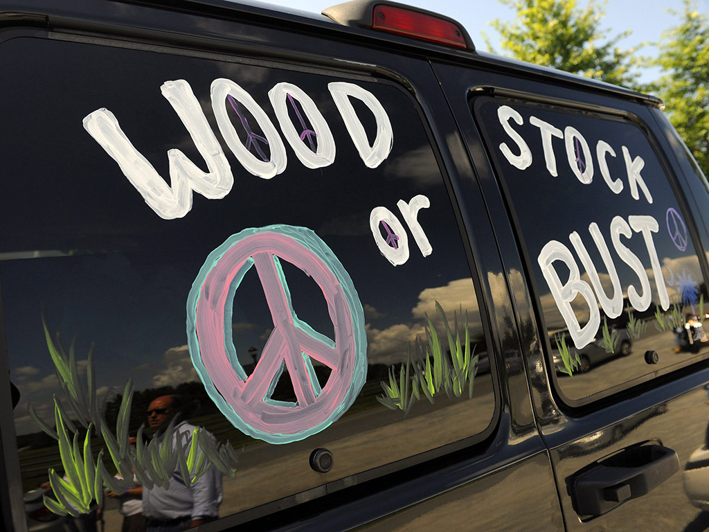 A van decorated with 'Woodstock or Bust' at the original Woodstock Festival site in Bethel, N.Y.