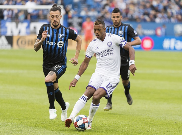 Montreal Impact's Maximiliano Urruti, left, and Saphir Taider, right, close in on Orlando City SC's Nani during second half MLS soccer action in Montreal, Saturday, June1, 2019.