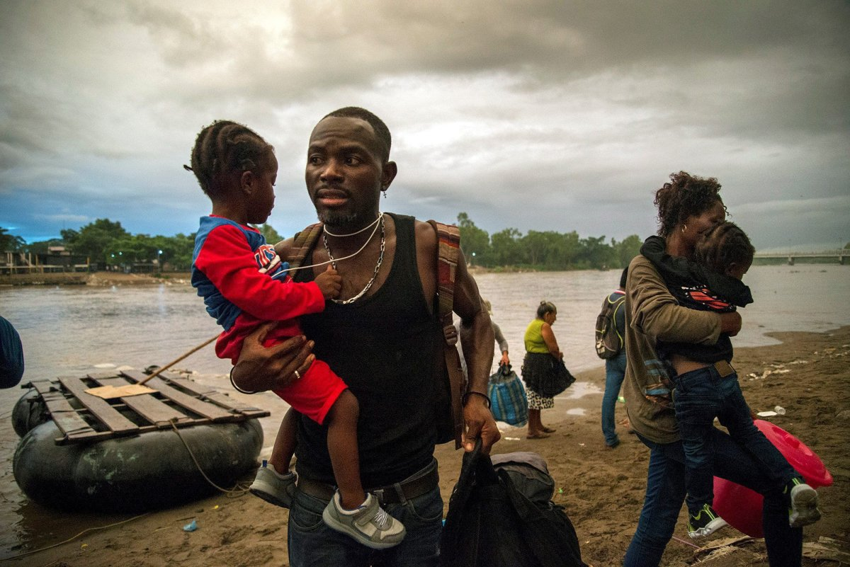African migrants enter Mexican territory after crossing of the Suchiate River, which marks the border line with Mexico and Guatemala, in the state of Chiapas, Mexico, 02 June 2019 (issued 04 June). The flow of migrants along the Suchiate River, which separates Mexico from Guatemala, continues despite the reinforcement of Mexico's security measures and repeated threats from US President Donald Trump. It is six o'clock in the morning, and a group of people illegally cross this river, including people coming from Africa who flee away from their nations looking for a better future in Mexico and the United States.