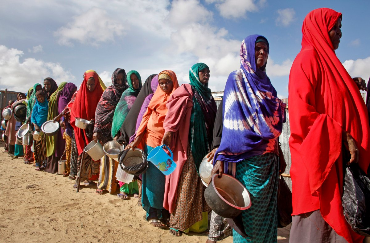 In this Saturday, May 18, 2019 file photo, newly-arrived women who fled drought line up to receive food distributed by local volunteers at a camp for displaced persons in the Daynile neighbourhood on the outskirts of the Somalian capital Mogadishu.