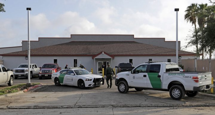 In this Saturday, June 23, 2018, file photo, a U.S. Border Patrol Agent walks between vehicles outside the Central Processing Center in McAllen, Texas.