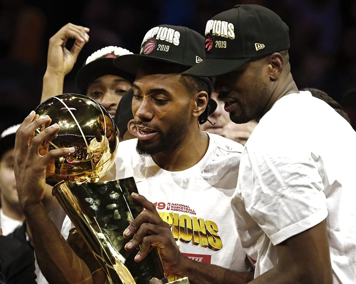 Toronto Raptor Kawhi Leonard holds up the Larry O'Brien NBA Championship Trophy after beating the Golden State Warriors in the NBA Finals.