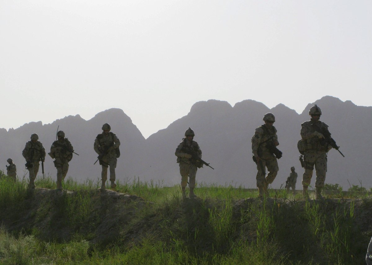 A site has been officially approved for the federal government's promised national monument for the war in Afghanistan, five years after the memorial was first promised. Canadian soldiers patrol an area in the Dand district of southern Afghanistan on Sunday, June 7, 2009.