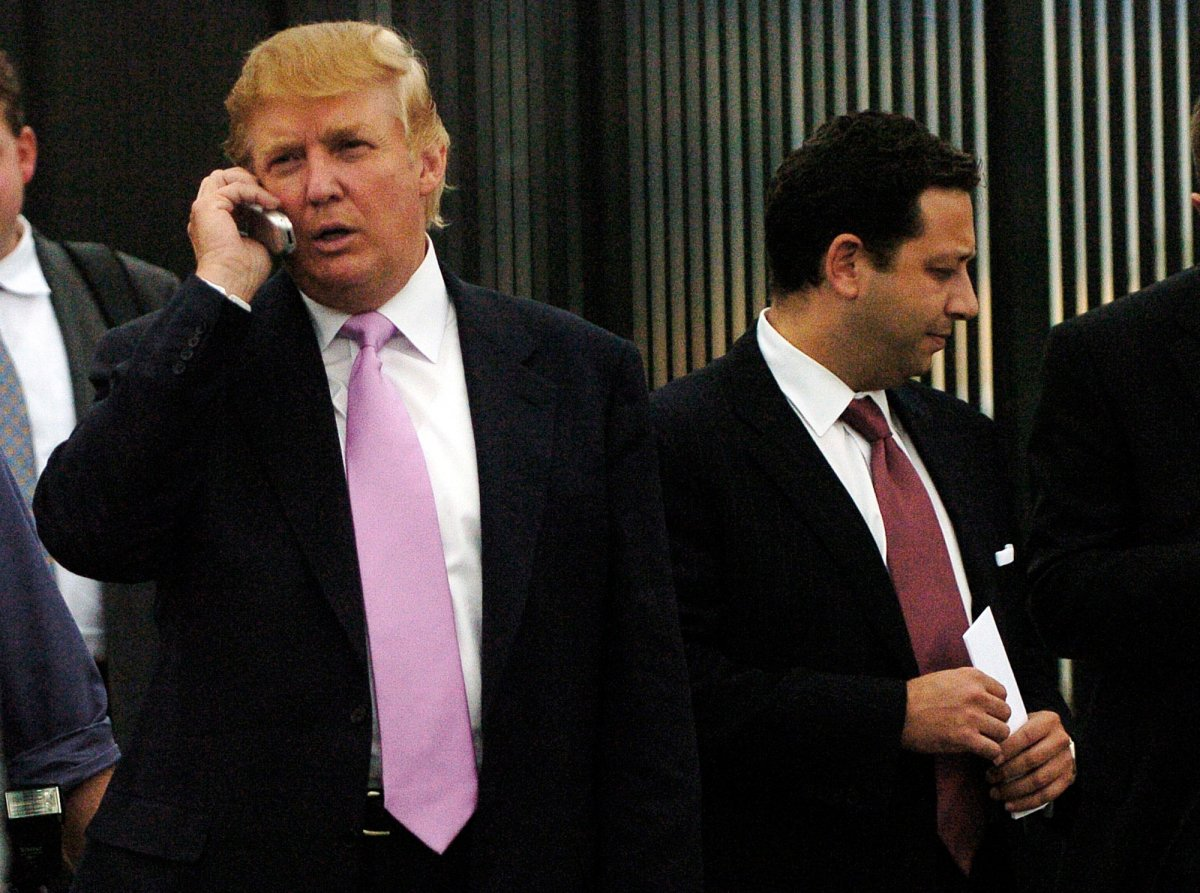 FILE - In this Sept. 14, 2005, file photo, businessman Donald Trump, left, talks on his cellphone with Felix Sater, right, outside after speaking at the Bixpo 2005 business convention at the Budweiser Events Center in Loveland, Colo.