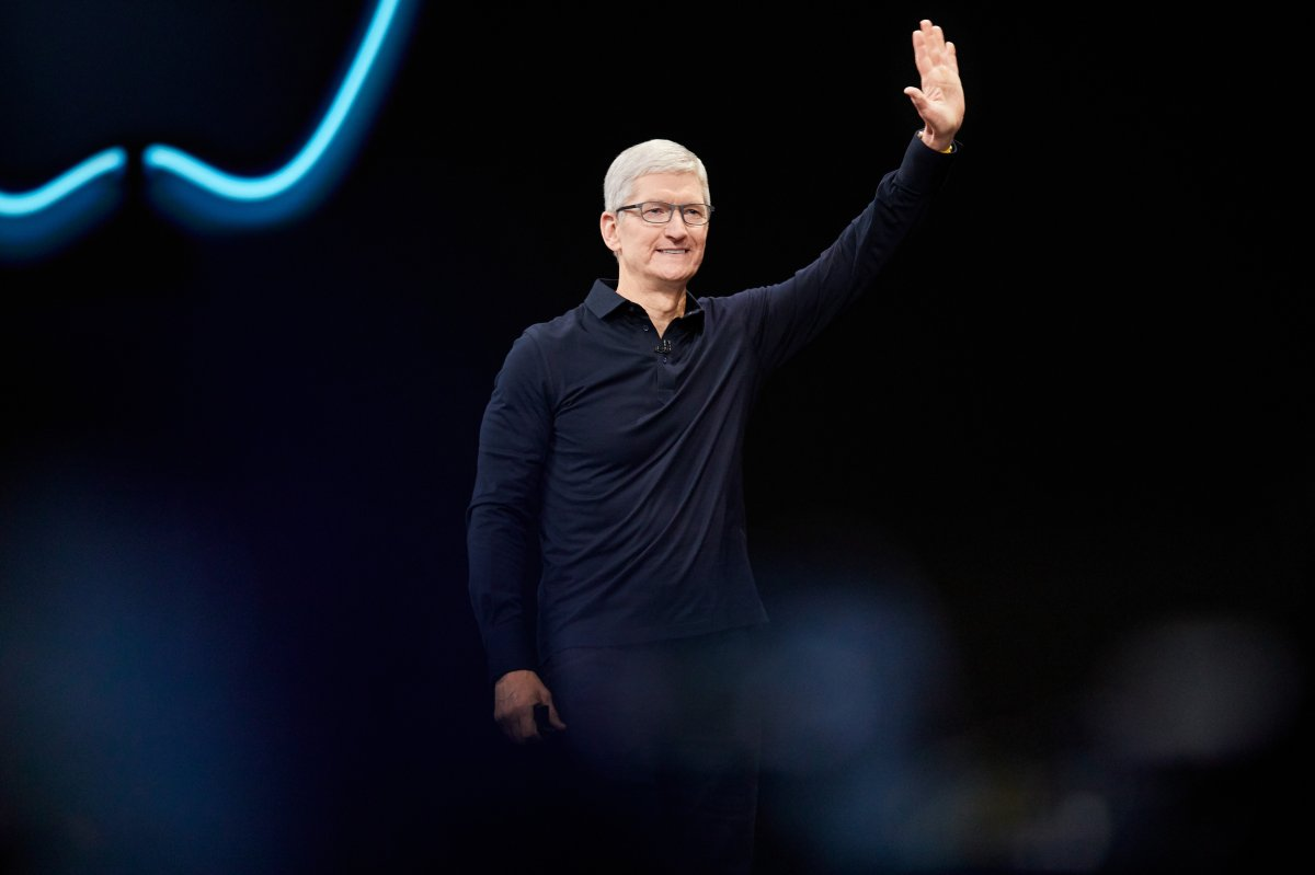 FILE - Tim Cook waves to the audience during Apple's WWDC 2019 developer conference.