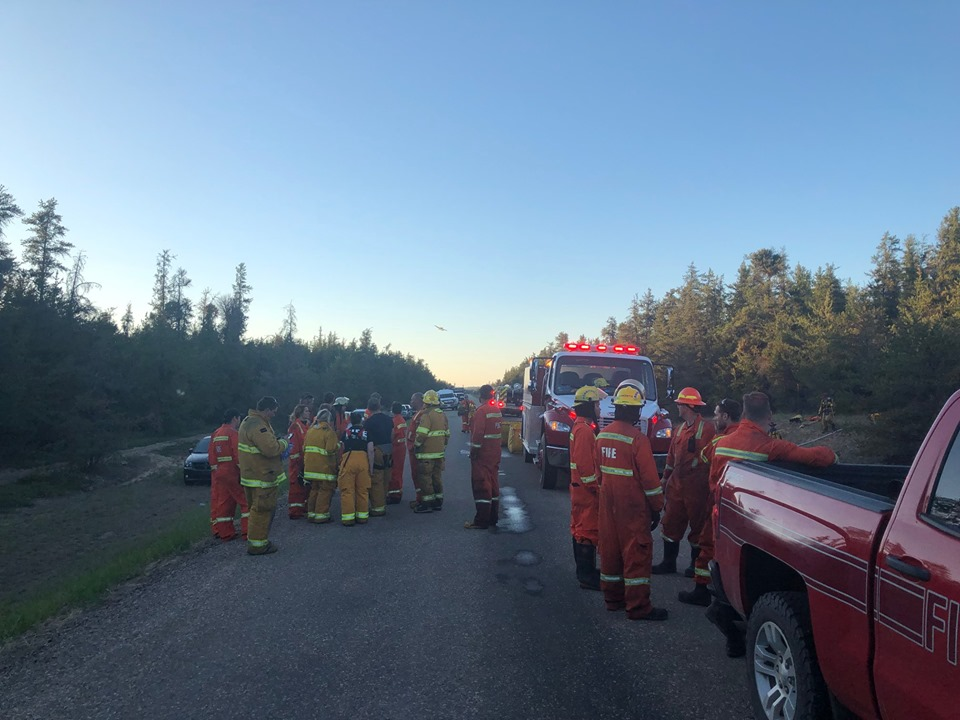 Bonnyville Regional Fire Authority firefighters and crews from Bonnyville, Glendon, La Corey and Iron River as well as Alberta Agriculture and Forestry at the scene of a wildfire near Bonnyville, Alta., on Tuesday, June 4, 2019.