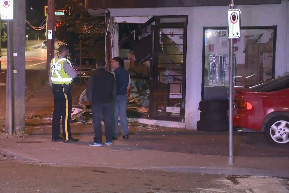 A storefront was heavily damaged after two cars collided in Burnaby early Sunday, June 16, 2019, sending one vehicle spinning into the front of Edmonds Motors.