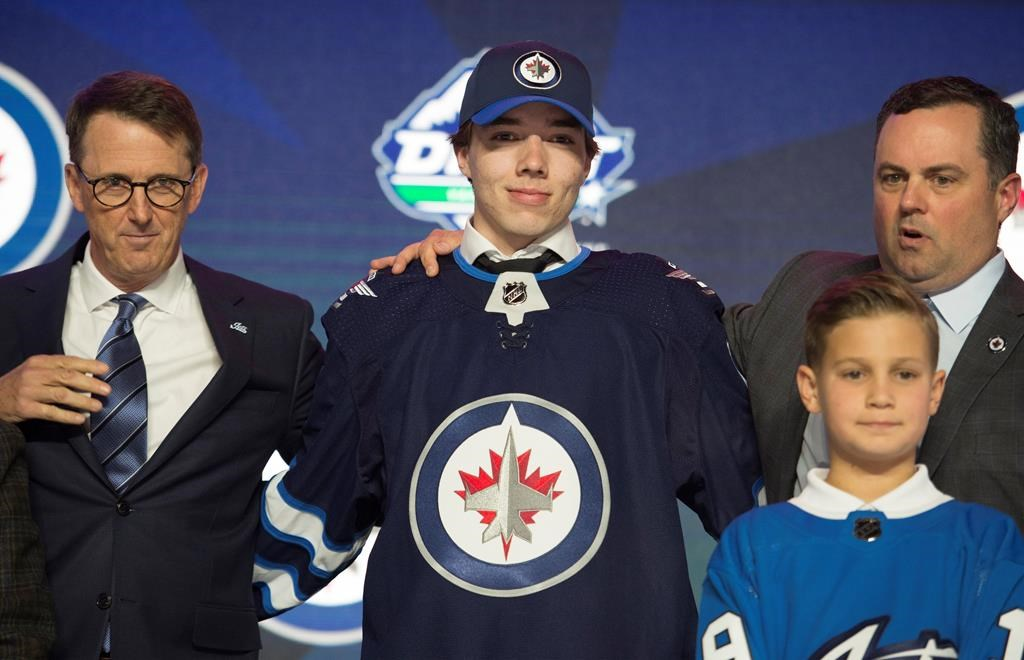 Winnipeg Jets select Ville Heinola during the first round NHL draft at Rogers Arena in Vancouver, Friday, June, 21, 2019. THE CANADIAN PRESS/Jonathan Hayward.