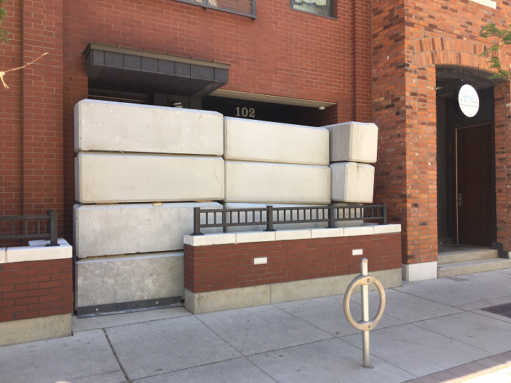 Concrete blocks could be seen blocking the entrance of an alleged illegal marijuana dispensary on St. Nicholas Street in Toronto.