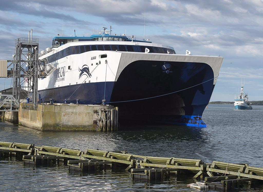 The CAT, a high-speed passenger ferry, prepares to depart Yarmouth, N.S. heading to Portland, Maine on its first scheduled trip on Wednesday, June 15, 2016. The heavily subsidized ferry between Nova Scotia and Maine says it won't be able to start on schedule at the end of this month because of delays related to renovating its new terminal in Bar Harbor.