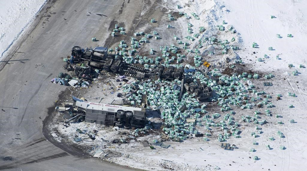 The wreckage of a fatal crash involving the team bus for the the Humboldt Broncos hockey team outside of Tisdale, Sask., is seen Saturday, April, 7, 2018.