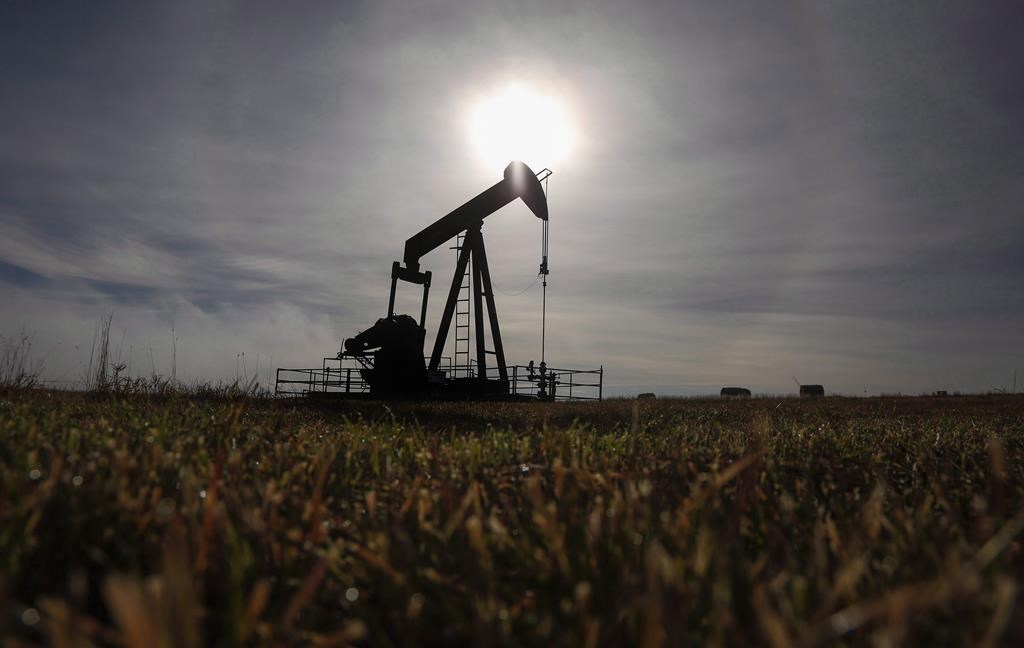 File: A pumpjack works at a well head on an oil and gas installation near Cremona, Alta., Saturday, Oct. 29, 2016.