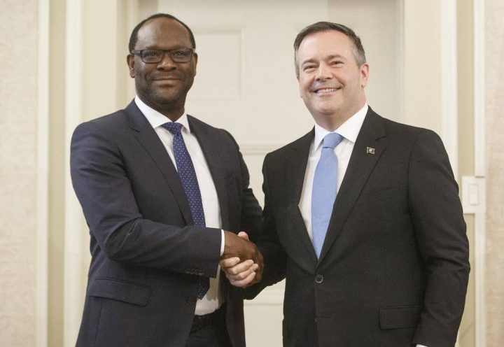 Alberta Premier Jason Kenney shakes hands with Minister of Municipal Affairs Kaycee Madu after being sworn into office in Edmonton on Tuesday April 30, 2019.