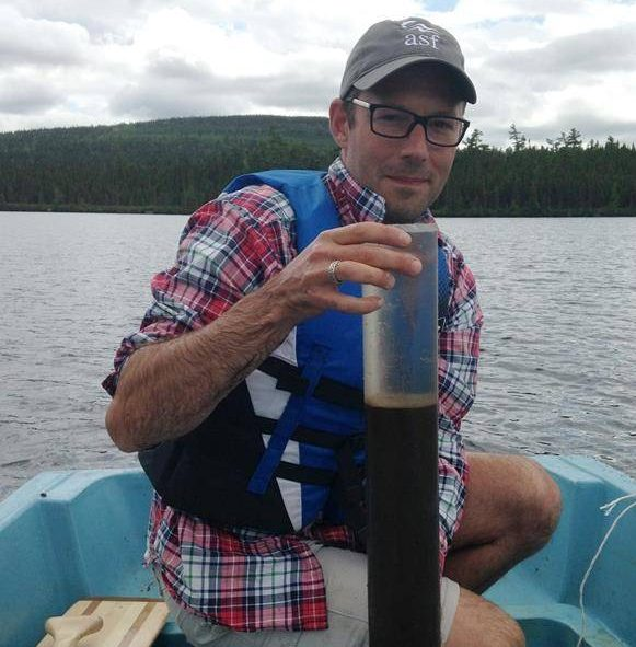 Environmental scientist and lead author Dr. Josh Kurek with a lake sediment core from Sinclair Lake, New Brunswick is shown in this handout image.