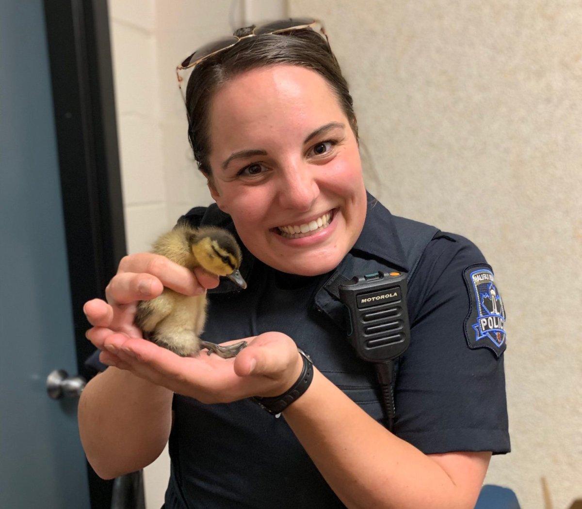 Halifax Regional Police Const. Alyssa Borutski holds Floop the duckling.