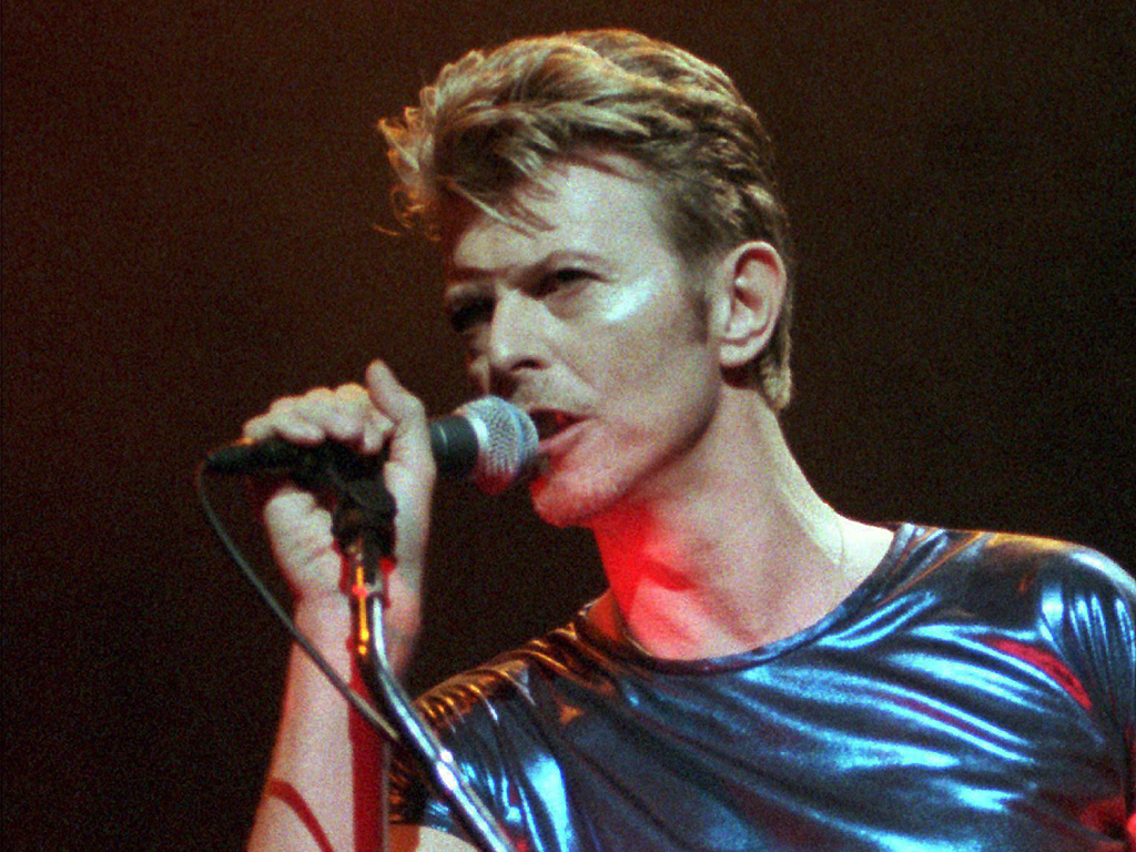 David Bowie performs during a concert in Hartford, Conn., on Sept. 14, 1995.