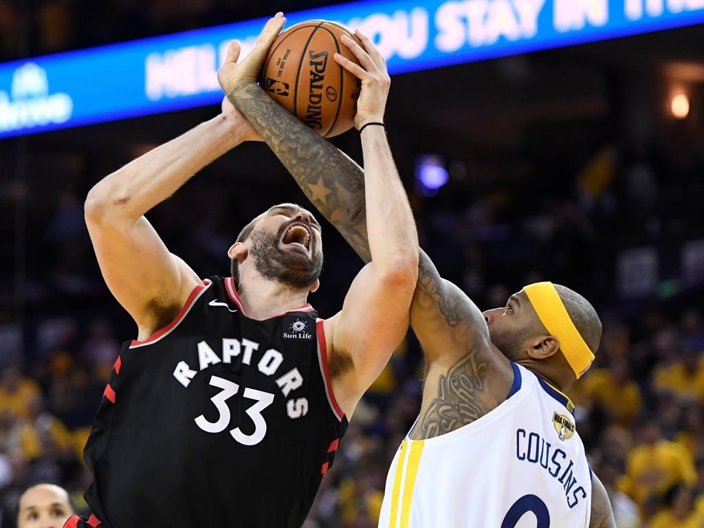 Toronto Raptors centre Marc Gasol,left and Golden State Warriors centre DeMarcus Cousins battle for the ball during second half basketball action in Game 3 of the NBA Finals in Oakland, California on Wednesday.