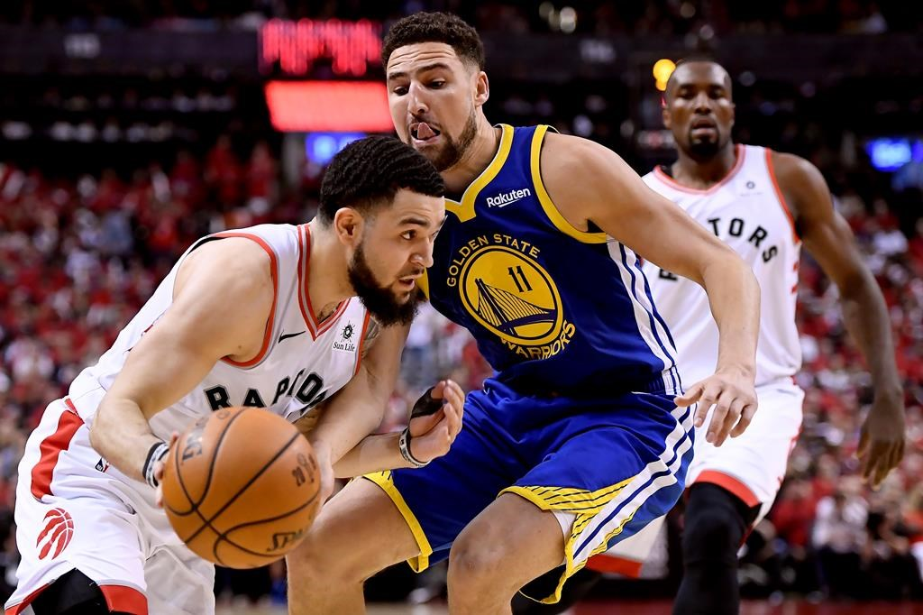Toronto Raptors guard Fred VanVleet (23) moves the ball around Golden State Warriors guard Klay Thompson (11) during second half Game 2 NBA Finals action, in Toronto on Sunday, June 2, 2019.