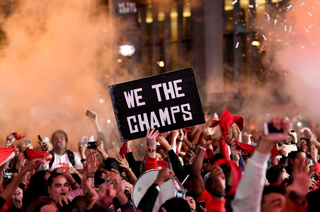 Toronto Raptors fans react at Jurassic Park, outside of the Scotiabank Arena in Toronto, as they watch the Raptors defeat the Golden State Warriors in Game 6 of the NBA Finals to win the NBA Championship, Thursday, June 13, 2019.