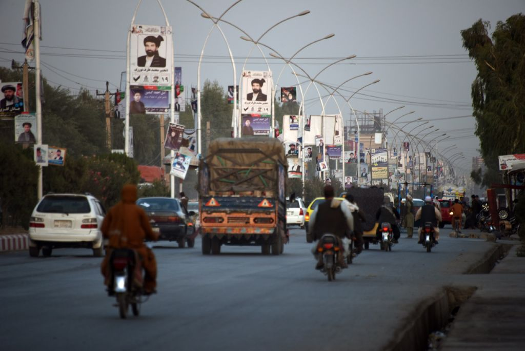 Posters of candidates are pictured along a road ahead of legislative election in Kandahar province on October 26, 2018.