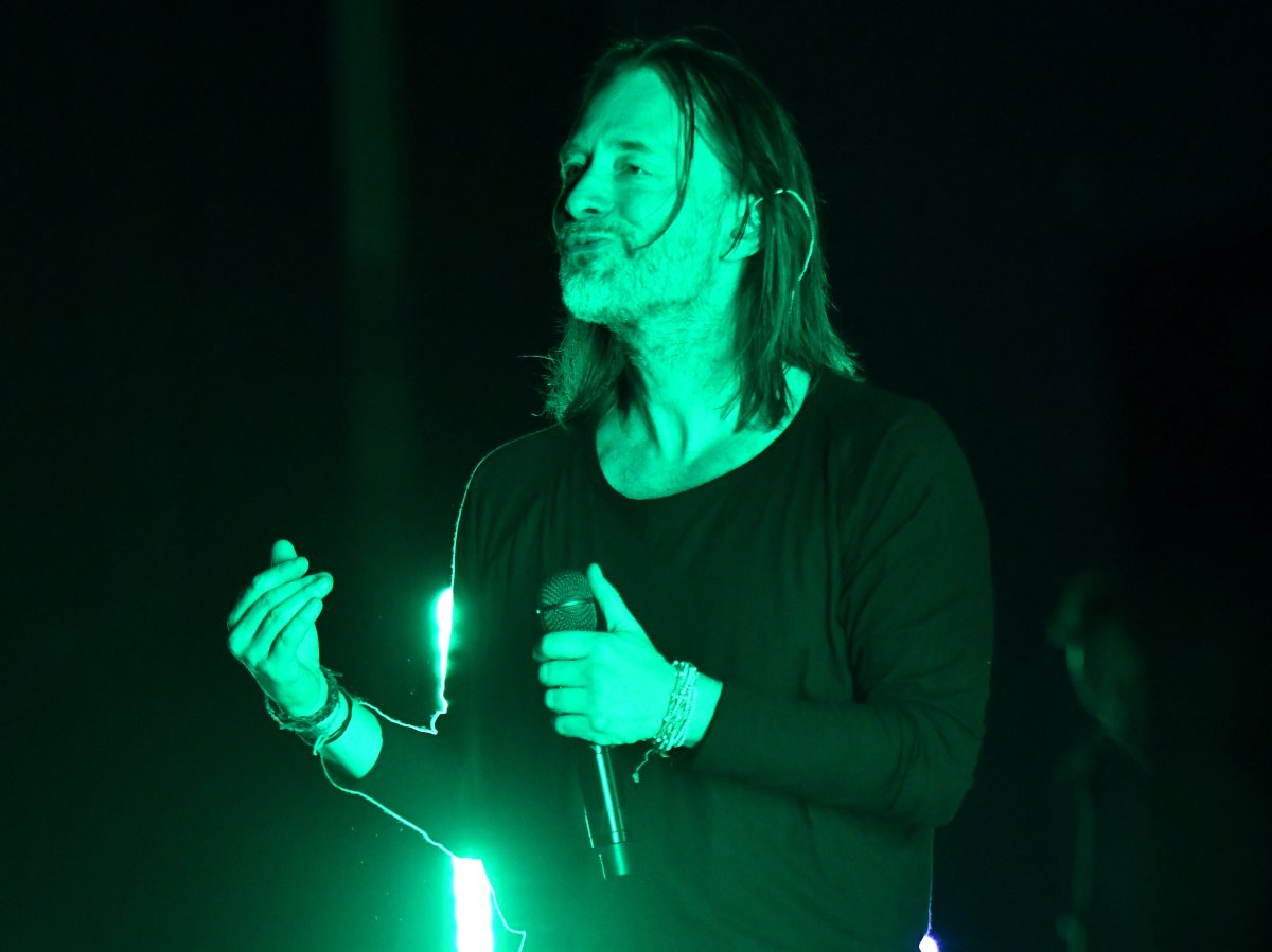 Thom Yorke of Radiohead performing live onstage.