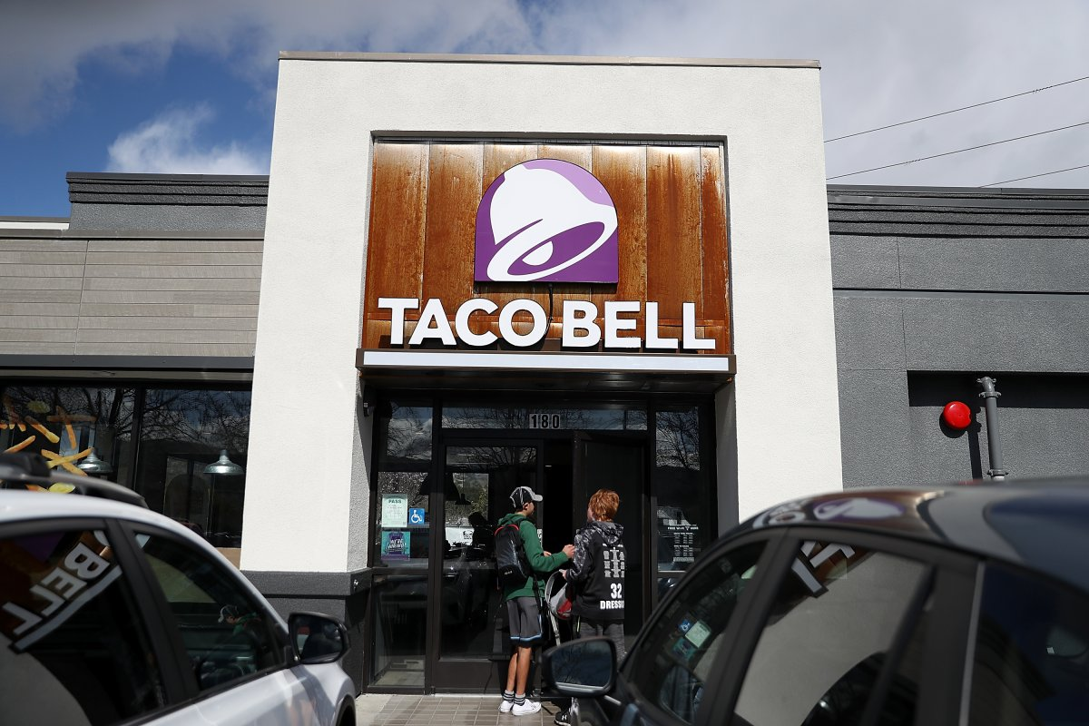 NOVATO, CA - FEBRUARY 22:  Customers enter a Taco Bell restaurant on February 22, 2018 in Novato, California. Taco Bell has become the fourth-largest domestic restaurant brand by edging out Burger King. Taco Bell sits behind the top three restaurant chains McDonald's, Starbucks and Subway.  (Photo by Justin Sullivan/Getty Images).