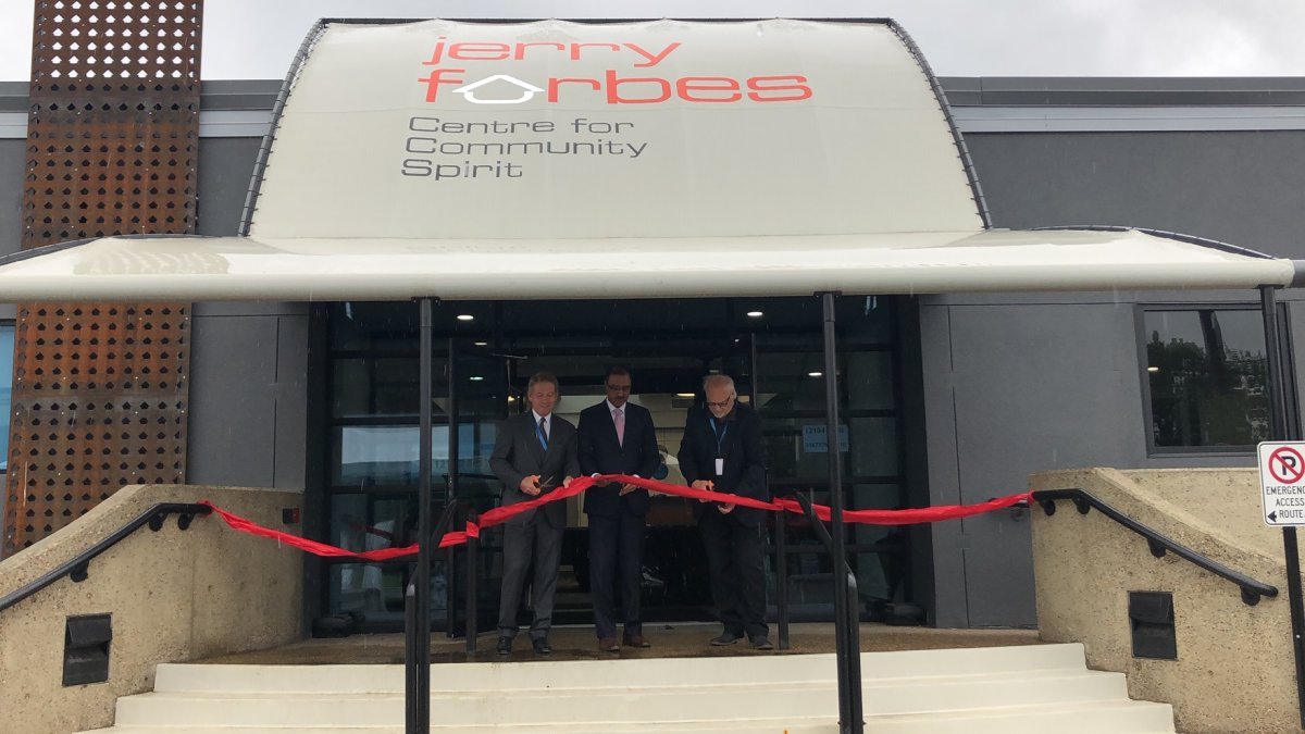 Board chair Brian Farrell, MP Amarjeet Sohi and Jerry Forbes' son Marty Forbes cut the ribbon at the grand opening of the Jerry Forbes Centre for Community Spirit on June 24, 2019.