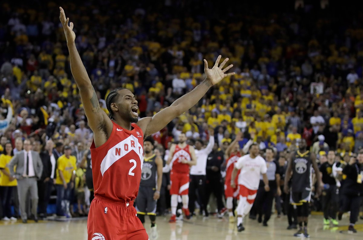 Toronto Raptors forward Kawhi Leonard celebrates after the Raptors defeated the Golden State Warriors in Game 6 of basketball's NBA Finals in Oakland, Calif., Thursday, June 13, 2019.