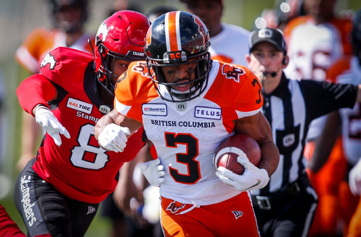 B.C. Lions' John White IV, right, runs the ball out of bounds as Calgary Stampeders' DaShaun Amos chases during first half CFL football action in Calgary, Saturday, June 29, 2019.